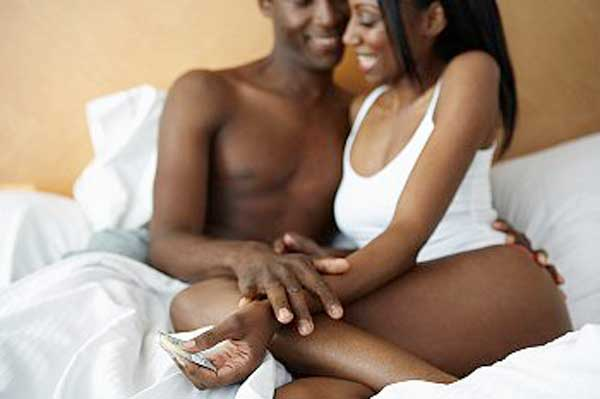 couple-in-bed-with-condom